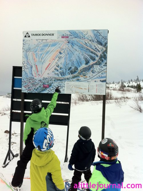 The kids checking the ski map to prepare for their first green run, the mile run (yup, it's a mile). They had just come up on their first chair lift. So many fun firsts.